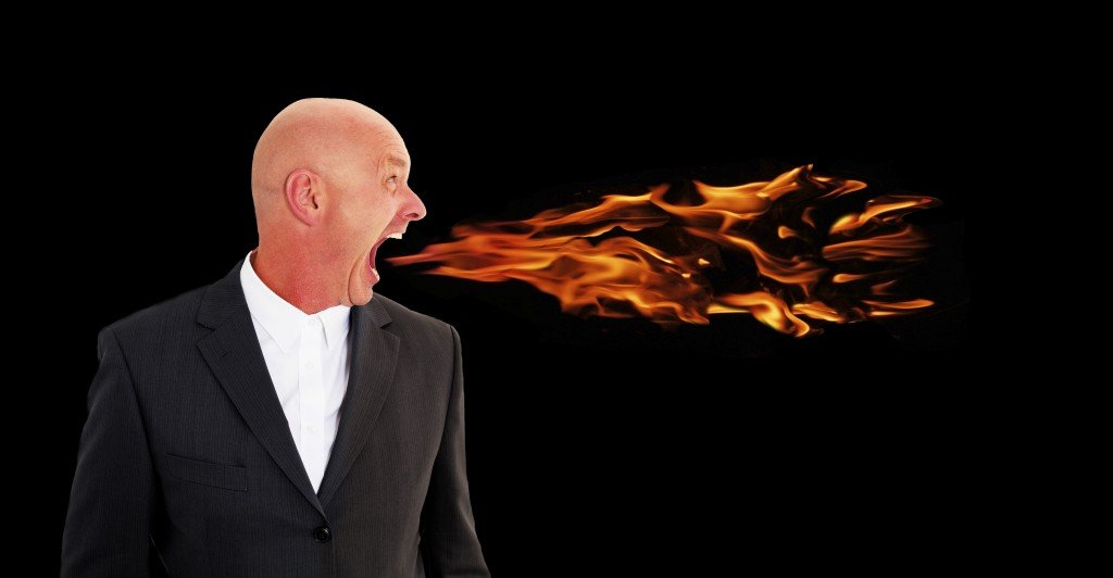 businessman screaming with flames coming out of his mouth